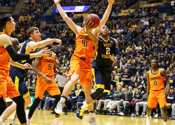 Feb 10, 2018; Morgantown, WV, USA; West Virginia Mountaineers guard Jevon Carter (2) shoots in the lane during the second half against the Oklahoma State Cowboys at WVU Coliseum. Mandatory Credit: Ben Queen-USA TODAY Sports