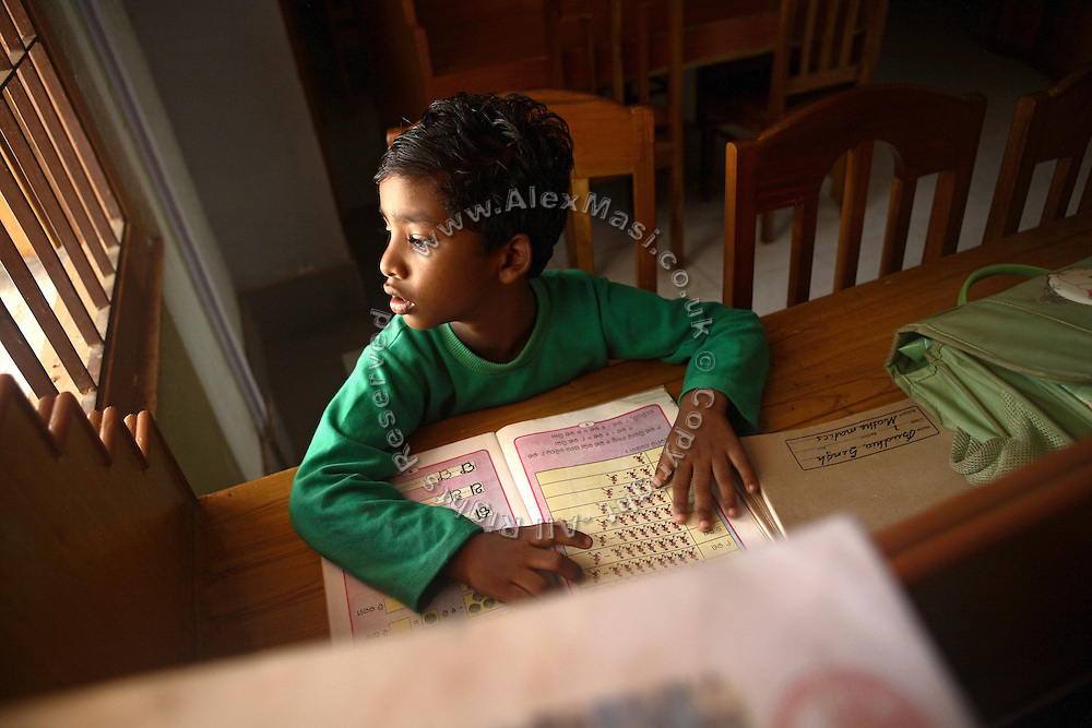 Budhia Singh, 6, the famous Limca World Record marathoner, is working on his homework in the library of D.V.A. Public School in Bhubaneswar, the capital of Orissa State, on Sunday, May 18, 2008. On May 1, 2006, Budhia completed a record breaking 65 km run from Jagannath temple, Puri to Bhubaneswar. He was accompanied by his coach Biranchi Das and by the Central Reserve Police Force (CRPF). On 8th May 2006, a Government statement had ordered that he stopped running. The announcement came after doctors found the boy had high blood pressure and cardiological stress. As of 13th August 2007 Budhia's coach Biranchi Das was arrested by Indian police on suspicion of torture. Singh has accused his coach of beating him and withholding food. Das says Singh's family are making up charges as a result of a few petty rows. On April 13, Biranchi Das was shot dead in Bhubaneswar, in what is believed to be an event unconnected with Budhia, although the police is investigating the case and has made an arrest, a local goon named Raja Archary, which is now in police custody. **Italy and China Out**