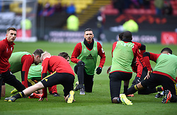Watford's Jose Holebas (centre) and teammates warm up ahead of the match