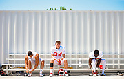 University of South Dakota football players gear up for practice Wednesday, August 7, 2019, on the practice field near the Dakotadome in Vermillion.