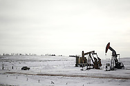 Oil pump jacks are seen along Interstate 94 in the Bakken Formation near Belfield, North Dakota in January 2017.<br /> <br /> The oil industry in North Dakota supports much of its economic stability and infrastructure. According to a recent study by Grand Forks firm AE2S Nexus, cities in North Dakota's oil-heavy Bakken Formation are expected to see a growth in population as oil prices recover. The population growth will require an expansion of city infrastructure and services to keep up with demands needed to provide for its residents.