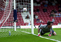 Photo: Catrine Gapper.<br /> Brentford v Bristol City. Coca Cola League 1.<br /> 24/09/2005.<br /> Brentford's goal keeper Stuart Nelson, diving to save bristol City's Luke Wilkshire's goal scoring free kick.