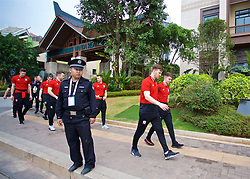 NANNING, CHINA - Monday, March 26, 2018: Local police stand guard as Wales players Lee Evans and Ben Woodburn go on a team walk near the Wanda Realm Resort on day seven of the 2018 Gree China Cup International Football Championship ahead of the final against Uruguay. (Pic by David Rawcliffe/Propaganda)