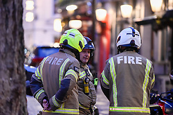 © Licensed to London News Pictures. 03/02/2020. LONDON, UK. Firefighters in discussion near Old Compton Street. Scenes in Soho where the public have been evacuated by police and emergency services are in attendance after reports of an unexploded WW2 bomb being discovered in the area.  A wide cordon has been established from Shaftesbury Avenue, Charing Cross Road and the streets around Old Comption Street.  Photo credit: Stephen Chung/LNP