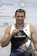 Poznan, POLAND,  GBR AM1X, Tom AGGAR, with his Gold medal after winning the final,  at the 2008 Beijing Olympics  at the 2008 Olympic Qualification  Rowing Regatta. Malta Rowing Course on Wednesday, 18/06/2008. [Mandatory Credit:  Peter SPURRIER / Intersport Images] . Rowing Course:Malta Rowing Course, Poznan, POLAND