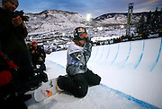 SHOT 1/26/08 5:21:28 PM - Snowboarder Shaun White takes a breather on the deck of the superpipe during practice for the elimination round Saturday January 26, 2008 at Winter X Games Twelve in Aspen, Co. at Buttermilk Mountain. White would qualify in second later that evening and went on to win the event the next night with a gold medal run of 96.66. The 12th annual winter action sports competition features athletes from across the globe competing for medals and prize money is skiing, snowboarding and snowmobile. Numerous events were broadcast live and seen in more than 120 countries. The event will remain in Aspen, Co. through 2010..(Photo by Marc Piscotty / © 2008)