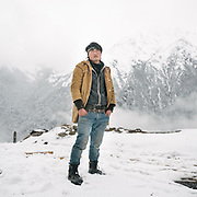 Tenzing Norbu, a carpenter and recently married man. A walk around Laya village during a snow storm.