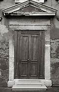 Definitely not a straight door. Taken in Campo Sant'Alvise, a small square in the Sestiere of Cannaregio, Venice, Italy
