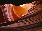 Bizarre water sculpted scenery within a slickrock slot canyon, Colorado Plateau.