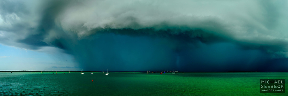 A spectacular thunderstorm charges over Darwin Harbour in the wet season.