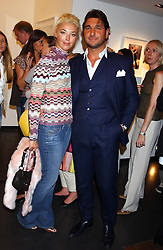 MISS TAMARA BECKWITH and MR GEORGE VERONI at a party to celebrate the opening of an exhibition of photographs by the late Norman Parkinson held at Hamiltons gallery, 13 Carlos Place, London W1 on 14th September 2004.<br />