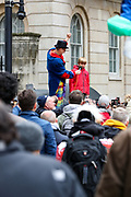 "A speaker gives a platform to a child to address to protesters who gathered holding placards during a ""Match the Million"" march for free speech, free assembly, and freedom from lockdowns outside Downing Street in Central London, on Saturday, Oct 10, 2020. (VXP Photo/ Vudi Xhymshiti)"