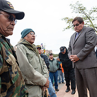 Pete Tsinnijinnie, the Chinle commander, center, addresses the speakers statements as Micheal Redhouse, 73, and the Honorable LoRenzo C. Bates  listen, outside of the Navajo Nation Council Chambers in Window Rock on Wednesday.