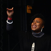 London, UK. 4th March 2018. Speaker Dr Shola Mos-Shogbamimu at the Women's Day march 2018 marks 100 years since (some) women in the UK were legally allowed to vote. One hundred years on women still marching for equality demand 50/50 women in  Paliament calling for an end sexual harassment, violence and rape.
