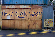 A Hand car Wash business in a London backstreet.