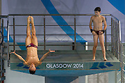Mcc0055084 . Daily Telegraph<br /> <br /> England's Tom Daly training alongside 14 yr old Matthew Dickson at the Royal Commonwealth Pool in Edinburgh on Day 8 of the 2014 Commonwealth Games .