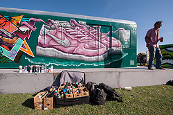 © Licensed to London News Pictures. 25/07/2015. Bristol, UK.  A mock train carriage is painted at Upfest 2015, Europe's largest, free, street art & graffiti festival, attracting over 250 artists painting 28 venues throughout Bedminster & Southville, Bristol.  Talented artists travel from 25 countries and across the UK to paint live on 30,000sqft of surfaces in front of 25,000 visitors. There is also an affordable art sale, music stages and art workshops.  Photo credit : Simon Chapman/LNP