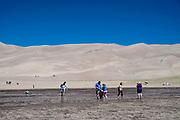 People enjoy exploring Great Sand Dunes National Monument, near Alamosa, Colorado, USA.