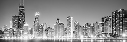 North Chicago skyline panorama photo in black and white. Panoramic photo ratio is 1:3 and includes the John Hancock Center building and other buildings along the Chicago Gold Coast and Streeterville neighborhoods. The John Hancock Center is one of the world's tallest skyscrapers and is a famous fixture in the Chicago skyline. Image Copyright © 2012 Paul Velgos with All Rights Reserved.