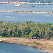 Barge going by Zelenenky island in Volga near Samara