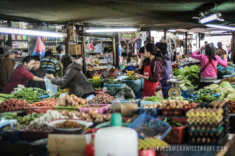 Fresh fruits and vegetables for sale at the large and bustling morning market in Phonsavan in northeastern Laos. The people of the region are predominantly of Hmong ethnicity.
