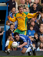 Photo: Leigh Quinnell.<br /> Chelsea v Norwich City. The FA Cup. 17/02/2007.<br /> Chelsea captain John Terry falls at the feet of Norwichs' Chris Brown.