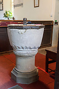 Norman circular font bowl in church of Saint Andrew, Etchilhampton, Wiltshire, England, UK