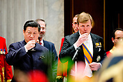 King Willem-Alexander, Queen Maxima and Princess Beatrix during the state banquet with Chinese President Xi Jinping and his wife Peng Liyuan at the Royal palace Amsterdam, The Netherlands, 22 March 2014. The Chinese president is in The Netherlands for a two day state visit before the NSS summit in The Hague. POOL