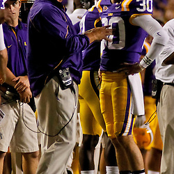 October 16, 2010; Baton Rouge, LA, USA; LSU Tigers kicker Josh Jasper (30) talks with head coach Les Miles after missing a kick near the end of the first half against the McNeese State Cowboys at Tiger Stadium.  Mandatory Credit: Derick E. Hingle