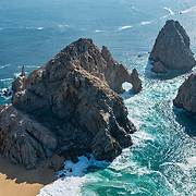 Aerial view of Lands End arch, lover's beach and Cabo San Lucas Bay.