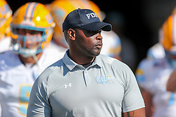 Sep 11, 2021; Morgantown, West Virginia, USA; Long Island Sharks defensive line coach Maurice Baker leads players out of the tunnel before their game against the West Virginia Mountaineers at Mountaineer Field at Milan Puskar Stadium. Mandatory Credit: Ben Queen-USA TODAY Sports
