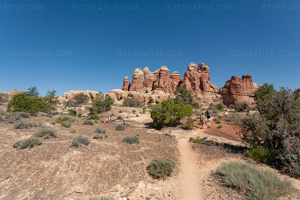 Hikers at Dollhouse Granaries — a trail located near Moab, Utah in a remote section of the Canyonlands. Photo © Robert Zaleski / rzcreative.com<br /> —<br /> To license this image for editorial or commercial use, please contact Robert@rzcreative.com