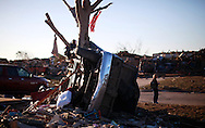 A tornado destroyed pickup truck is wrapped around a tree in Oklahoma City, Oklahoma May 22, 2013.  Rescue workers with sniffer dogs picked through the ruins on Wednesday to ensure no survivors remained buried after a deadly tornado left thousands homeless and trying to salvage what was left of their belongings.  REUTERS/Rick Wilking (UNITED STATES)