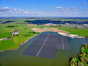 Nederland, Overijssel, Zwolle; 07-05-2021; Bomhofsplas, drijvend zonnepark op zandwinplas, gesitueerd vlak bij de A28.<br /> Bomhofsplas, floating solar park on the sand extraction location, located near the A28.<br />  <br /> luchtfoto (toeslag op standard tarieven);<br /> aerial photo (additional fee required)<br /> copyright © 2021 foto/photo Siebe Swart