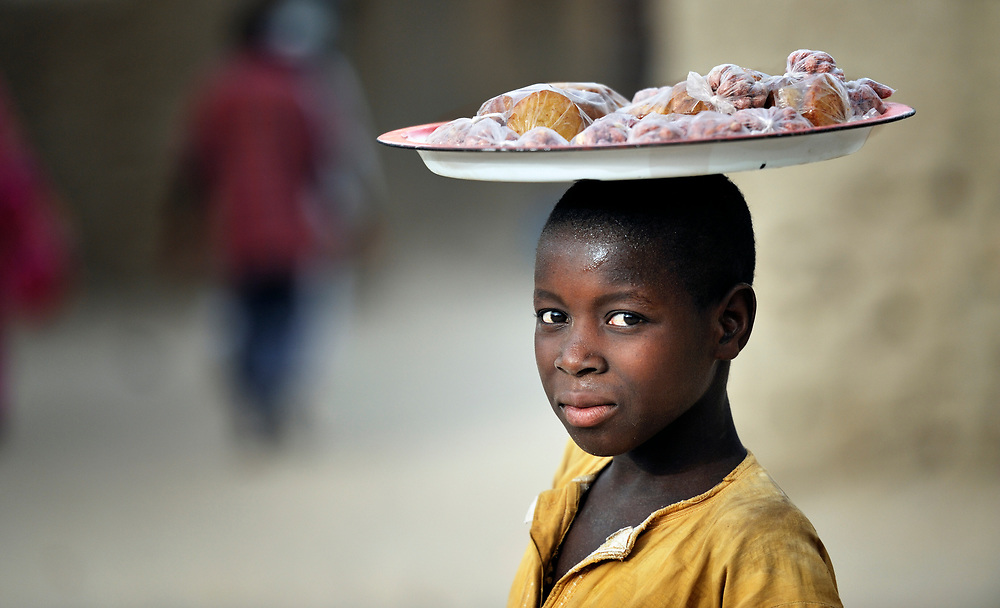A boy sells food in Timbuktu, the northern Mali city captured by Islamist forces in 2012 and liberated by French and Malian soldiers in 2013.