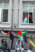 London, United Kingdom, May 15, 2021: A local resident shows her support through the windows of her apartment during a pro-Palestinian rally outside the Israeli Embassy in central London on Saturday, May 15, 2021. This is the 3rd week of ongoing demonstrations across the United Kingdom with 25 demonstrations taking place across the country today. (Photo by Vudi Xhymshiti/VXP)
