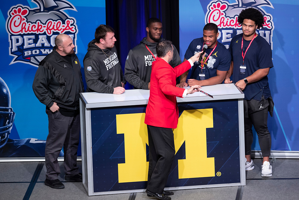 """The Michigan Wolverines and the Florida Gators participate in """"Battle for Bowl Week"""" games at the College Football Hall of Fame on Wednesday, December 26, 2018, in Atlanta. Michigan will face Florida in the 2018 Chick-fil-A Peach Bowl NCAA football game on December 29, 2018. (Jeannie Abell via Abell Images for the Chick-fil-A Peach Bowl)"""