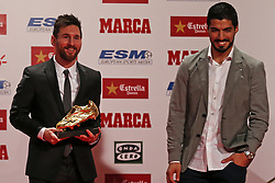 November 24, 2017 - Barcelona, Catalonia, Spain - Barcelona football player Luis Suarez (R) gives the Golden Boot award to Lionel Messi (L) at the Old Estrella Damn Factory on November 24, 2017 in Barcelona, Spain. (Credit Image: © Urbanandsport/NurPhoto via ZUMA Press)