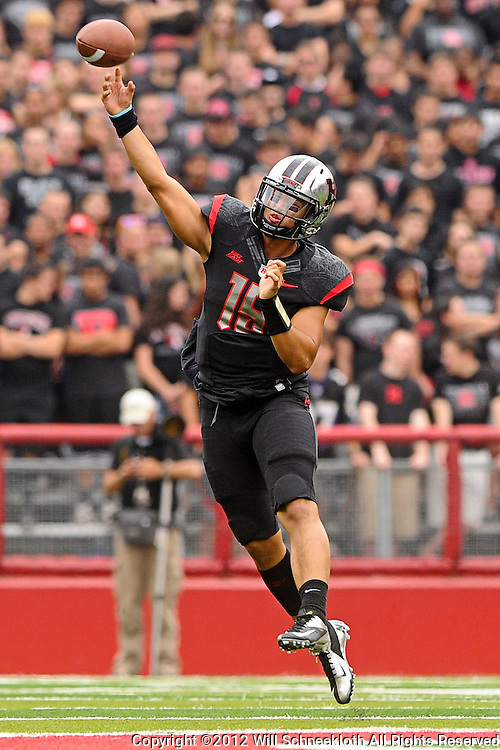 Oct 6, 2012: Rutgers Scarlet Knights quarterback Gary Nova (15) throws on the run during second half NCAA college football action between the Rutgers Scarlet Knights and UConn Huskies at High Point Solutions Stadium in Piscataway, N.J.