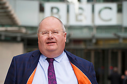 © licensed to London News Pictures. London, UK 09/02/2014. Communities Secretary Eric Pickles leaving BBC Broadcasting House in London after appearing on the The Andrew Marr show on BBC One and apologising to people who have been affected by floods and suggesting that chairman of the Environment Agency Chris Smith should resign. Photo credit: Tolga Akmen/LNP