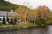 Traditional house on river in Fall.