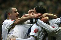 Photo: Paul Greenwood/Sportsbeat Images.<br />Leeds United v Huddersfield Town. Coca Cola League 1. 08/12/2007.<br />Leeds United's Andrew Hughes (L) congratulates David Prutton (C)