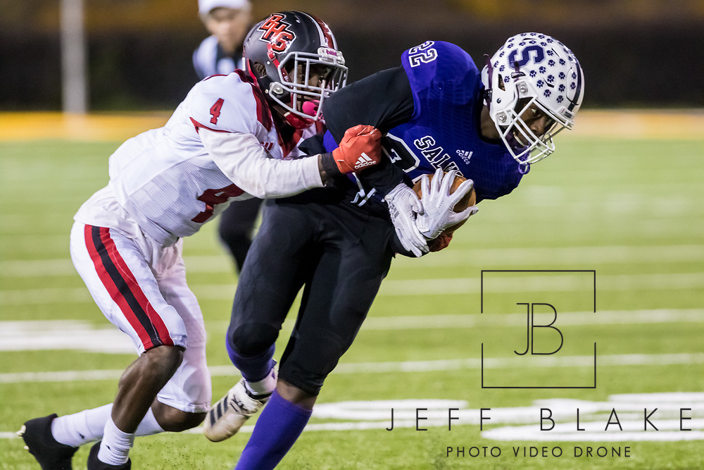 Saluda Tigers Montrevious Baker (22) is brought down by Barnwell Warhorses Ena Bynum (4) in the Class AA State Championship game. 2019 Saluda State Championship Football Photos