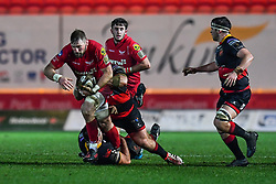 Scarlets' John Barclay is tackled by Dragons' Lloyd Fairbrother and Liam Belcher<br /> <br /> Photographer Craig Thomas/Replay Images<br /> <br /> Guinness PRO14 Round 13 - Scarlets v Dragons - Friday 5th January 2018 - Parc Y Scarlets - Llanelli<br /> <br /> World Copyright © Replay Images . All rights reserved. info@replayimages.co.uk - http://replayimages.co.uk