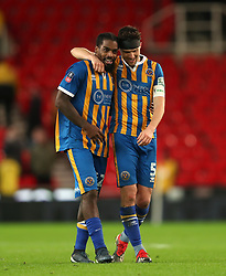 Shrewsbury Town's Anthony Grant (left) and Mat Sadler celebrate after the game