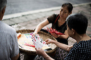 Chinese women play typical Chinese cards in Chengdu, China, August 8, 2014.<br /> <br /> Food and games are a real pleasure for the life of Chinese community. <br /> At home, in the streets, at the park or in restaurants, the chance to find someone eating or playing is considerably high.<br /> <br /> © Giorgio Perottino