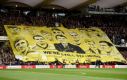 Watford fans show their support by holding a 'We're still standing' banner at Vicarage Road