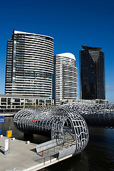 View of spectacular steel Webb footbridge and modern apartment buildings at Docklands district of Melbourne Australia