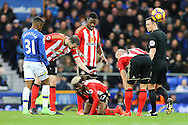 Didier Ndong of Sunderland on his knees injured. Premier league match, Everton v Sunderland at Goodison Park in Liverpool, Merseyside on Saturday 25th February 2017.<br /> pic by Chris Stading, Andrew Orchard sports photography.