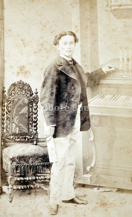 fading photo portrait man standing late 1800s